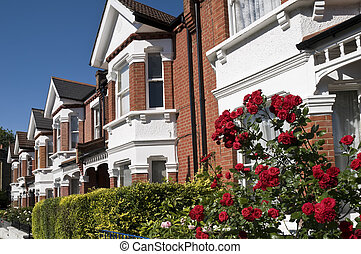 English Homes with roses - Row of Typical English Terraced...