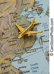 Plane Traveling Over ChinaMap is royalty free off of a...