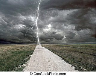tunder - rural road and cloudy sky with lightning