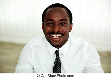Portrait of a laughing african man in office