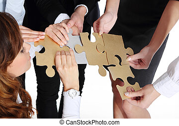 Group of people presents silver gold puzzle