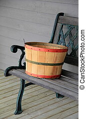Colorful basket on wood bench