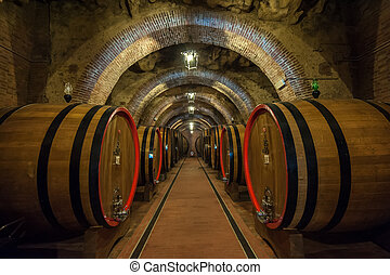 Wine barrels (botti) in a Montepulciano cellar, Tuscany -...