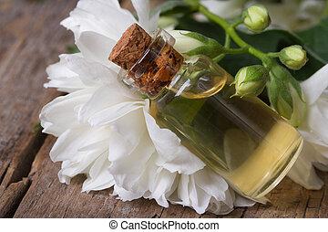 White jasmine flower macro and fragrant oil. horizontal.