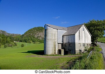 Norwegian Grain Silo 003 - Old grain silo and barn next to a...