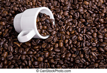 coffee beans and a white coffee cup