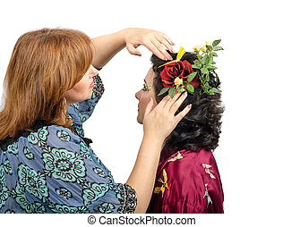 Putting in a red rose in black hair