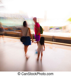 City people in skytrain station in motion blur