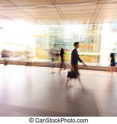 City people walking in skytrain station in motion blur