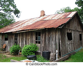 Old farm house with red tin roof - closeup of Old farm house...