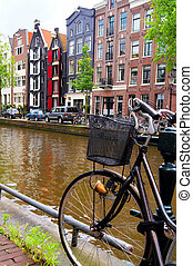 Amsterdam canals - Bicycle along the canals of Amsterdam,...
