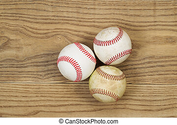 Used Baseballs on Aged Wood - Horizontal top view photo of...