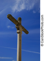 Stone Cross on blue sky
