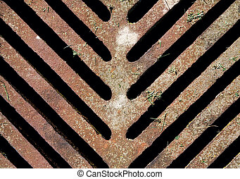 Old rusrty sewer manhole drain - Sewer manhole drain on the...