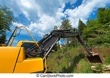 Yellow and Black Excavator Machine - Close up of tracked...