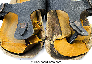 Old Sandals over white - Close up of A pair of old worn out...