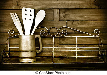Kitchen cooking utensils on rustic kitchen wall - Kitchen...