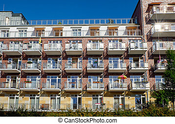 Apartment house with many balconies - Detailed view of an...