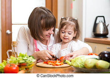 mom and kid preparing healthy food - mother and kid...