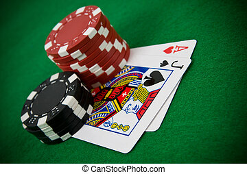 Ace of hearts and black jack with poker chips - Ace of...