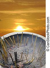 incense burning at sunrise