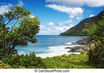 Small sandy beach between volcanic rocks - Path to Anse...