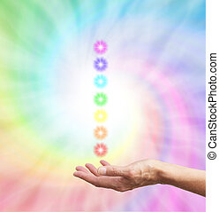 The Seven Chakras - healer's hand with palm up with a stack...