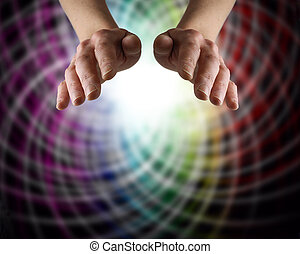 Colour Matrix Healing - Healer's hands hovering with a...