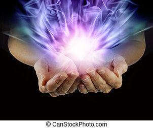 Magical energy in cupped hands - Woman with outstretched...