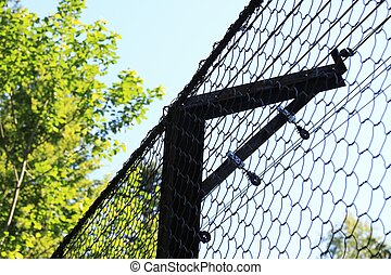 Wire netting - Chain link fence against blue background