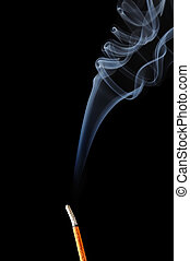Incense Stick with White Smoke on Black Background