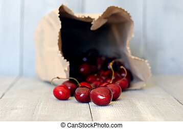Cherry  - Photo of ripe cherries on wooden background