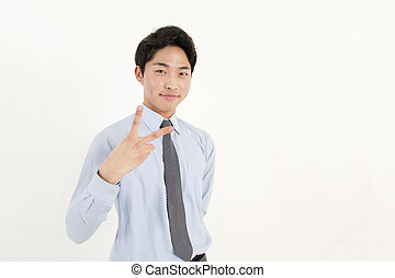 Peace! - Asian young businessman with two finger peace sign...