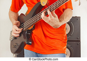 Rock musician playing bass guitar - Rock musician playing...