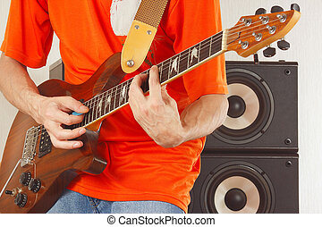 Posing hands of the musician playing electric guitar -...