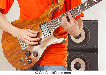 Hands of rock musician put guitar chords