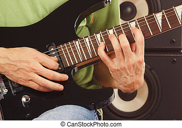 Hands of musician put guitar chords