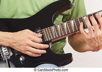 Guitarist playing the electric guitar closeup