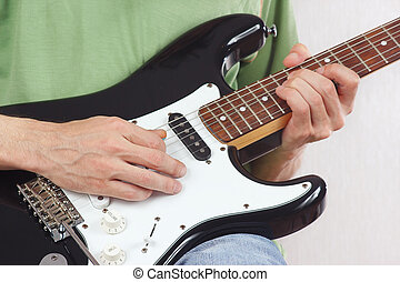 Posing hands of the rock musician playing electric guitar -...
