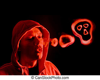Smoking kills - Hooded figure blowing smoke rings, lit from...