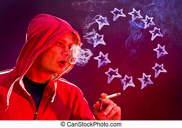 European Union - Man, holding a cigarette, blowing rings in...