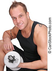 man lifting weights - happy fit adult man lifting steel...