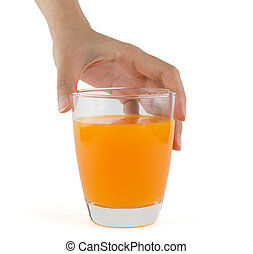 Hand holding a glass of orange juice