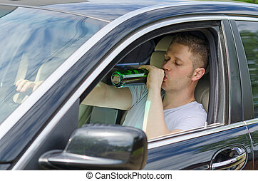 Driving Under the Influence. Man drinking alcohol in the...