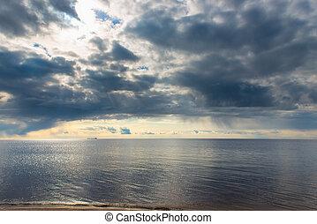 blue rain clouds over a calm sea