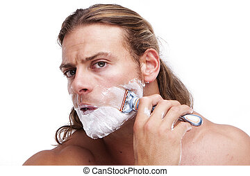time for shaving - Portrait of a young handsome man shaving...