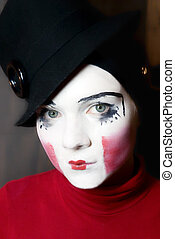 Portrait of sad mime in hat