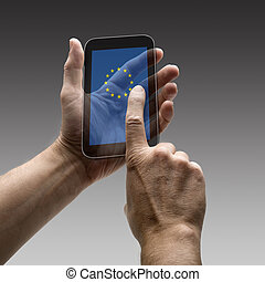 Holding Europe flag screen smart phone. There is a route for...