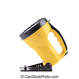 Yellow plastic pocket handle flashlight Isolated on a white...