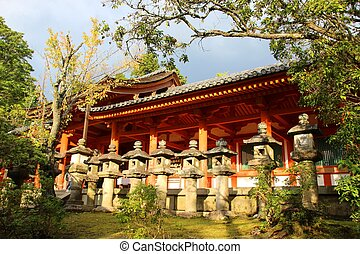 Traditional Japanese Temple - Line of concrete lanterns...